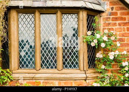 Old weathered leaded window of a garden house. - Stock Photo