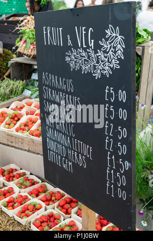 Fruit and veg sign at Daylesford Organic farm summer festival. Daylesford, Cotswolds, Gloucestershire, England. - Stock Photo