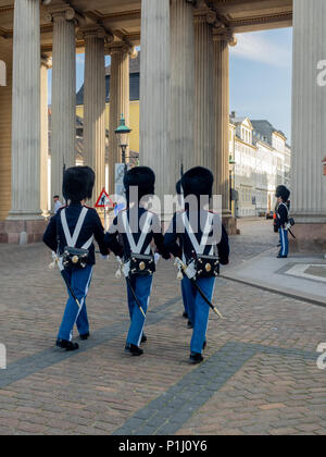 Changing of the Guards at Amalienborg Palace, home of the royal family, in Copenhagen, Denmark - Stock Photo