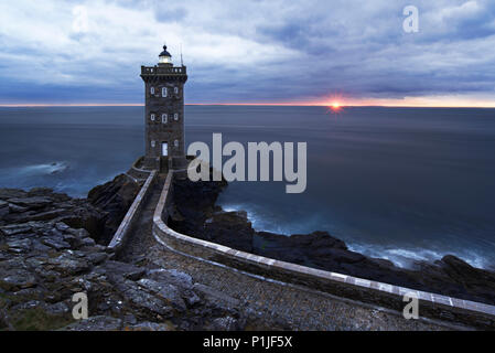 Phare de Kermorvan at sunset, Pointe de Kermorvan, Le Conquet, Brittany, France - Stock Photo
