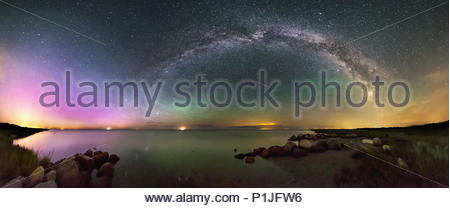 Panorama of Northern Lights (Aurora Borealis) with airglow, milky way and a shooting star (meteor) above the Baltic Sea on August 6th 2016, Helberskov Strand, Helberskov, Hadsund Sogn, Halbinsel Himmerland, Mariagerfjord, Nordjylland, Denmark - Stock Photo