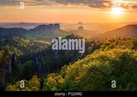 Sunset over the Elbe Sandstone Mountains, Saxon Switzerland, Saxony, Germany - Stock Photo