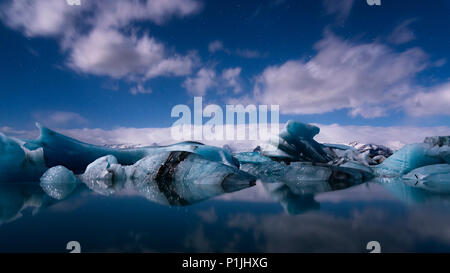 Starry sky at full moon over glacier lagoon, Jökulsarlon, Iceland - Stock Photo