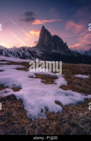 Melting snow and view on Nuvolau at Passo di Giau in the Dolomites, district of Belluno, Italia, Europe - Stock Photo