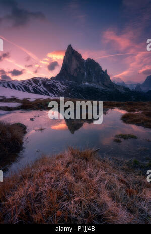 Melting snow and reflection of the Nuvolau at Passo di Giau in the Dolomites, district of Belluno, Italia, Europe - Stock Photo