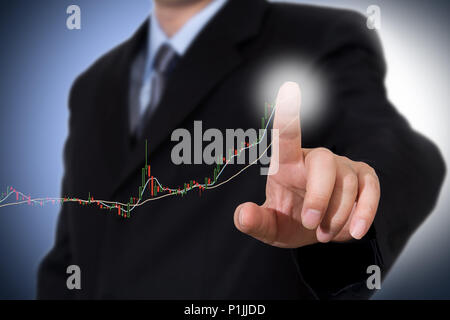 Businessman Touching a Graph Indicating Growth. - Stock Photo