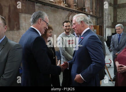 The Prince of Wales shakes hands with Sinn Fein MLA Gerry Kelly at Carlisle Memorial Church in Belfast where he is meeting the organisations involved in the regeneration of the building as a permanent home for the Ulster Orchestra. - Stock Photo