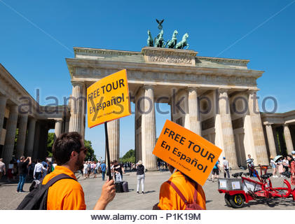 Tour guides offering services in Spanish  at Brandenburg Gate in Berlin, Germany - Stock Photo