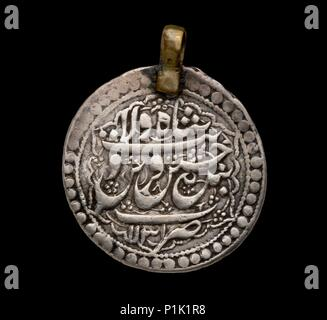 Islamic Coin, early 18th century.  Dimension: diameter: 27 mmweight: 5.52 g - Stock Photo