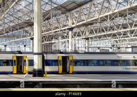 Empty South Western Railways train standing at a deserted  platform in Waterloo Station London England UK - Stock Photo