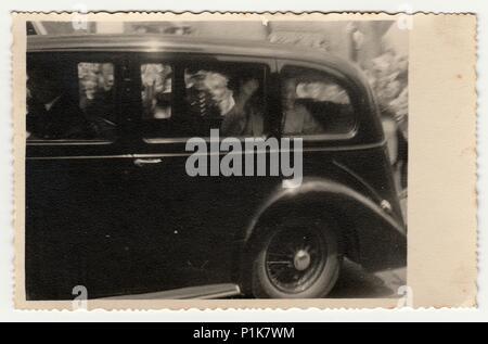 THE CZECHOSLOVAK  REPUBLIC - CIRCA 1930s: Vintage photo shows a historic car (vintage car). Black & white antique photography. - Stock Photo