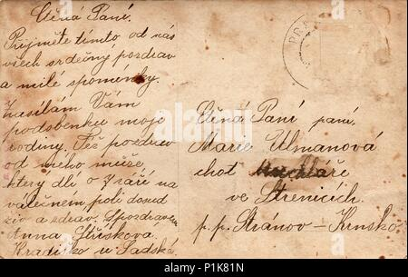 PRAGUE, AUSTRIA-HUNGARY - CIRCA 1915: Back of a vintage photo - postcard. Rich stain and paper details. Can be used as background. - Stock Photo