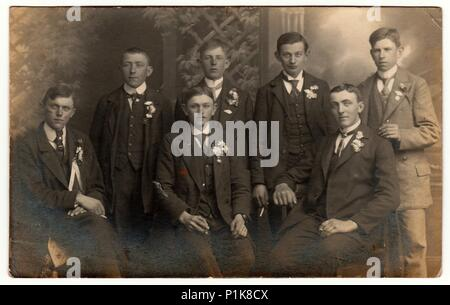 EILENBURG, GERMANY - CIRCA 1930s: Vintage photo shows young men (recruiters) pose at the photography studio. Black & white antique photography. - Stock Photo