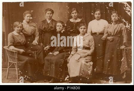 GERMANY - CIRCA 1930s: Vintage photo shows group of women pose at the photography studio. Black & white antique photography. - Stock Photo