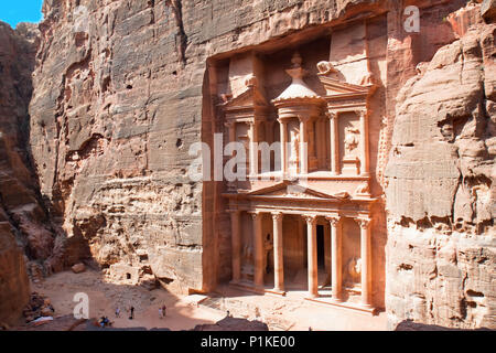 Treasury (Al-Khazneh) in ancient city of  Petra in Jordan. It was carved out of a single rocks. It is now an UNESCO World Heritage Site. Petra, Jordan - Stock Photo