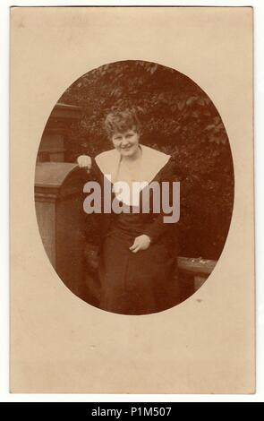 GERMANY - CIRCA 1940s: Vintage photo shows a mature woman. Photography is oval shaped. - Stock Photo