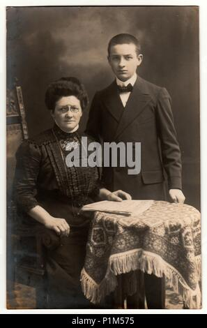 GERMANY - CIRCA 1930s: Vintage photo shows mother and her son. Black & white studio photography. - Stock Photo