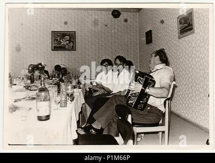 THE CZECHOSLOVAK SOCIALIST REPUBLIC - CIRCA 1970s: Retro photo shows people at the party. Black & white vintage photography. - Stock Photo