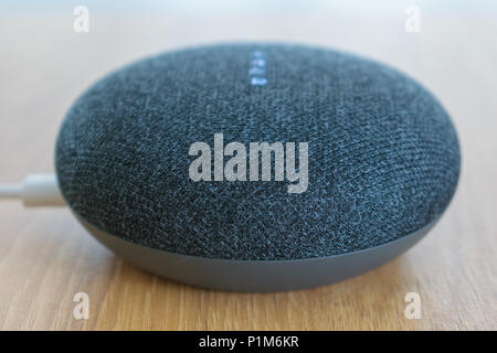 Athens, Greece - June 7 2018: Google home mini smart speaker with built in Google Assistant - Stock Photo