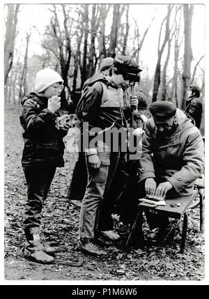 THE CZECHOSLOVAK SOCIALIST REPUBLIC - CIRCA 1980s: Retro photo shows young tourists and their chief in the forest. Black & white vintage photography - Stock Photo