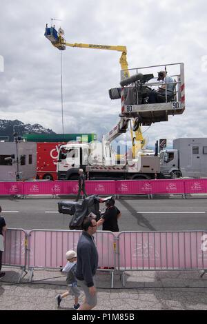 A cameraman on a platform crane filming the finish line at the Criterium du Dauphiné 2018 Stage 6 La Rosière Avergne Rhone Alpes Savoie - Stock Photo