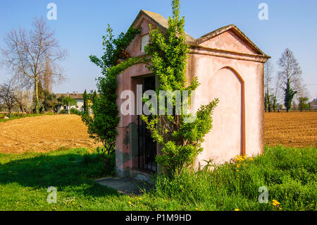 Religious shrine on the banks of the River Po in the Venetia region, Venice, Italy - Stock Photo