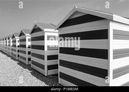 Row of beach huts on Hastings beach, on the Sussex coast, UK - Stock Photo