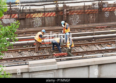 126th Street New York USA. Railroad workers working on the track. 2018 - Stock Photo