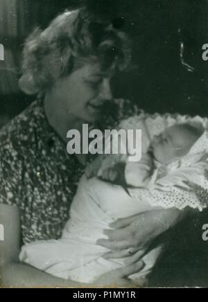 THE CZECHOSLOVAK SOCIALIST REPUBLIC - CIRCA 1960s: Retro photo shows woman cradles newborn baby. Vintage black & white photography. - Stock Photo
