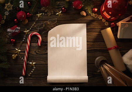 Christmas background, blank paper sheet on wooden table with copy space - Stock Photo