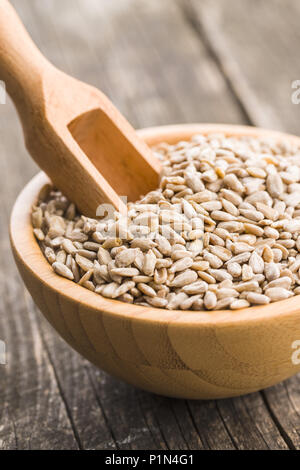Peeled sunflower seeds in bowl. - Stock Photo