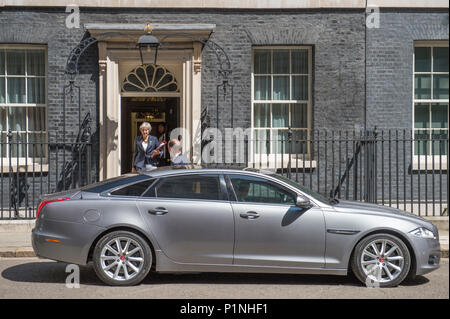 10 Downing Street, London, UK. 13 June, 2018. British Prime Minister Theresa May leaves 10 Downing Street on her way to Parliament attending Prime Minister's Question Time which takes place at 12 noon on Wednesdays. Credit: Malcolm Park/Alamy Live News. - Stock Photo