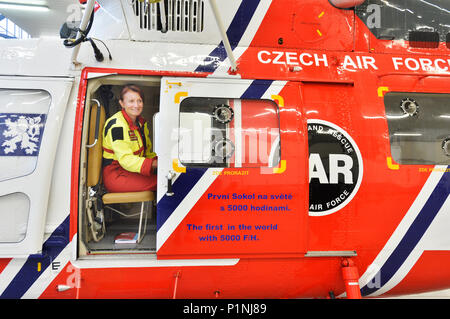 Pilsen, Czech Republic. 13th June, 2018. The first Sokol army helicopter (W-3A Sokol, 0718) with 5000 flight hours in the world belongs to air rescue service with airbase in Line village, near Pilsen, Czech Republic. On the photo is seen nurse Miroslava Wodecka in the helicopter in a hangar on June 13, 2018. Credit: Miroslav Chaloupka/CTK Photo/Alamy Live News - Stock Photo