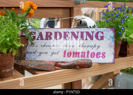 Gardening sign in a greenhouse amongst flowers on display at a flower show. UK - Stock Photo