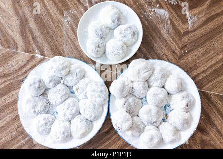 Many round whole mochi sticky glutinous rice cake dessert pieces, wagashi daifuku filled with red bean adzuki jam or ice cream filling flat top view o - Stock Photo