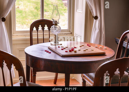 Checkers Game Set Up On a Table in a Historic Home - Stock Photo