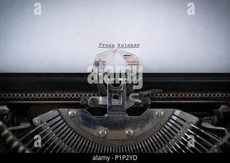The phrase Press Release  typed on an old Typewriter - Stock Photo