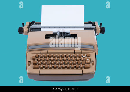 Old Vintage Typewriter with paper isolated on a blue background background - Stock Photo