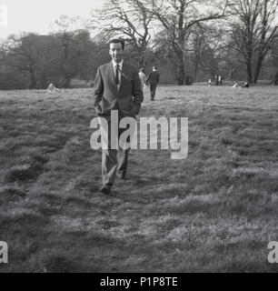 1951, historical, smartly dressed gentleman taking a walk in Richmond Park, Richmond, Surrey, England, UK. - Stock Photo