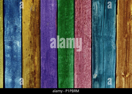 Texture of old wooden fence painted in different colors, close-up - Stock Photo