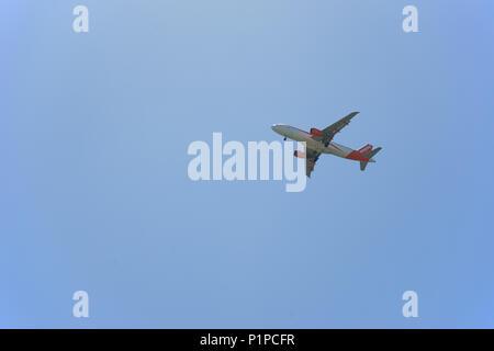 Easyjet Plane in flight over Naples, Italy - Stock Photo
