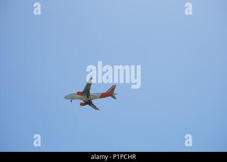 Easyjet Airplane in the sky - Naples, italy - Stock Photo