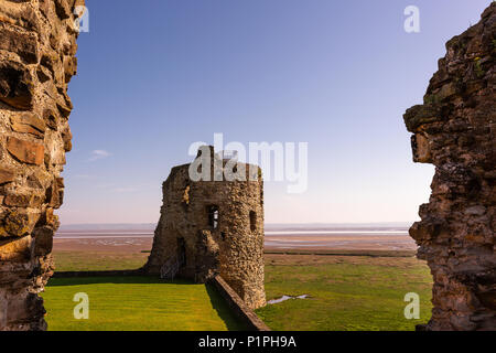 Ruins of Flint castle situated near the seaside in Wales, the United Kingdom on early spring morning - Stock Photo
