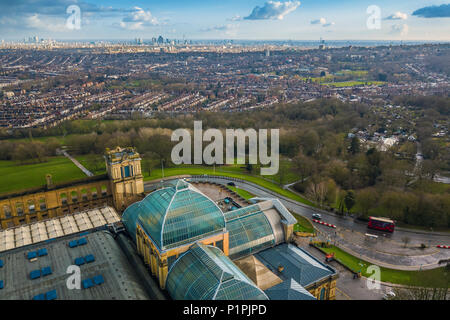 London, England - Aerial skyline view of north London with red doulbe decker bus, taken from Alexandra Park at Muswell Hill. This view includes Alexan - Stock Photo