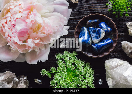 Sodalite and Quartz with Peony and Queen Anne's Lace on Dark Table - Stock Photo