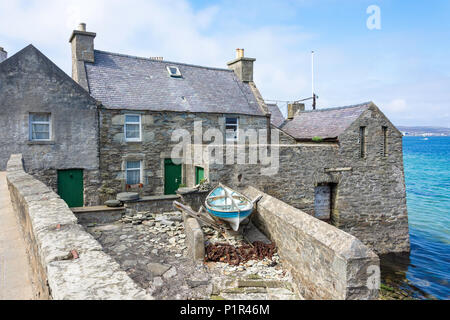 Stone cottage in harbour (Jimmy Perez house in TV Shetland series), Lerwick, Shetland, Northern Isles, Scotland, United Kingdom - Stock Photo