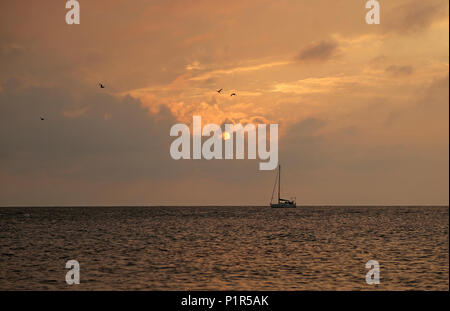 Kuehlungsborn, Germany, sailboat in the morning on the Baltic Sea - Stock Photo