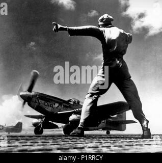 A P-51D Mustang fighter named 'MY GIRL' takes off from Iwo Jima. 1945 - Stock Photo