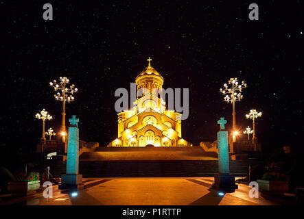 The Holy Trinity Cathedral or Tsminda Sameba Church at night in Tbilisi, Georgia - Stock Photo