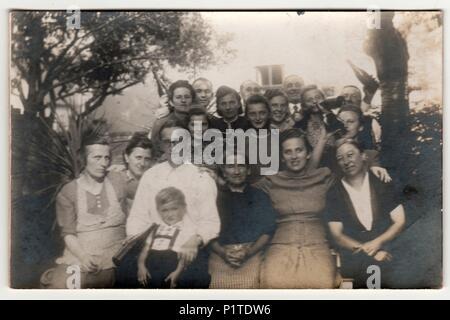 THE CZECHOSLOVAK REPUBLIC - CIRCA 1930s: Vintage photo shows rural people pose outdoor. Retro black & white photography. - Stock Photo